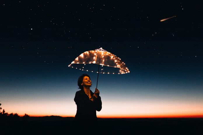 woman using umbrella with lights