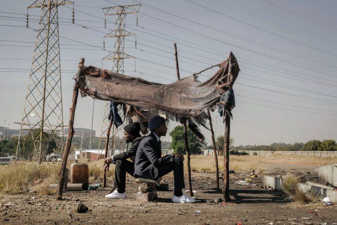 african american successful men came back in poor village